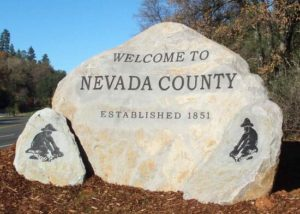 Welcome to Nevada County sign on rock